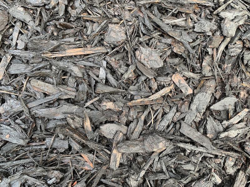 black wet mulch